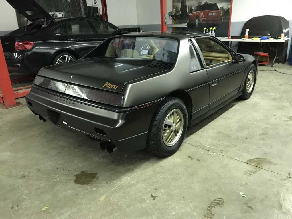 Full black gold sparkle wrap with decal on Pontiac Fiero